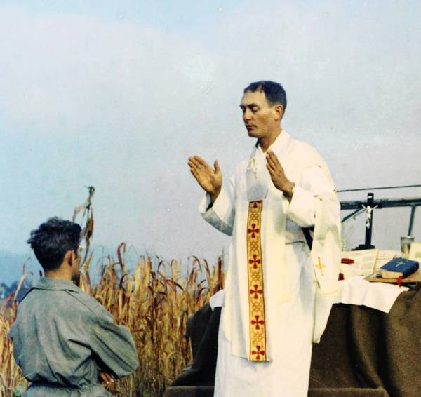 Army Capt. Emil Kapaun conducts Mass in October 1950, shortly before he was taken prisoner during the Korean War. He employed faith, selflessness and ingenuity to help his fellow prisoners of war endure harsh conditions.