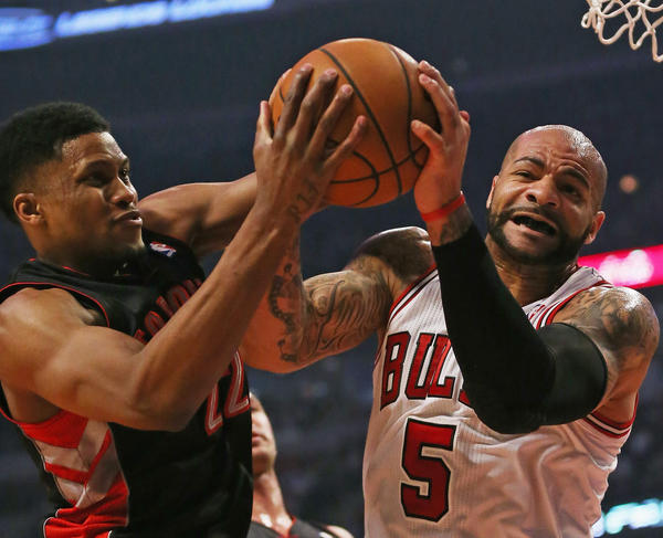 CHICAGO, IL - APRIL 09: Carlos Boozer #5 of the Chicago Bulls battles for a rebound with Rudy Gay #22 of the Toronto Raptors at the United Center on April 9, 2013 in Chicago, Illinois. NOTE TO USER: User expressly acknowledges and agrees that, by downloading and or using this photograph, User is consenting to the terms and conditions of the Getty Images License Agreement. (Photo by Jonathan Daniel/Getty Images) ORG XMIT: 152063303