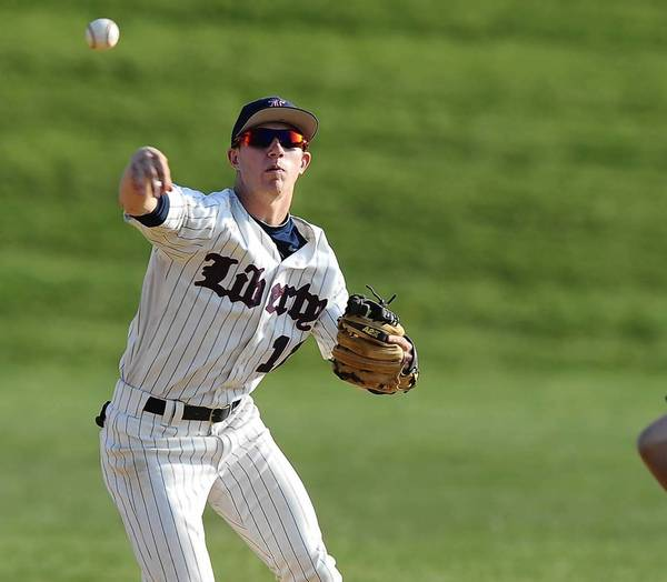 Liberty's SS Patrick Donnelly (left) doubles up Central Catholic's David Rosenberger (37) at second base during their baseball game Thursday April 19, 2012. Donnelly is the High School Player of the Week,