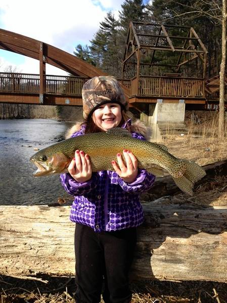 Kaitlyn Joseph, 6, of Allentown proudly displaying the 21 1/2-inch rainbow trout she landed in Lehigh County on April 3, 2013. Katie, also known as Lil Miss Troutdogg, landed 16 rainbow trout and released them.