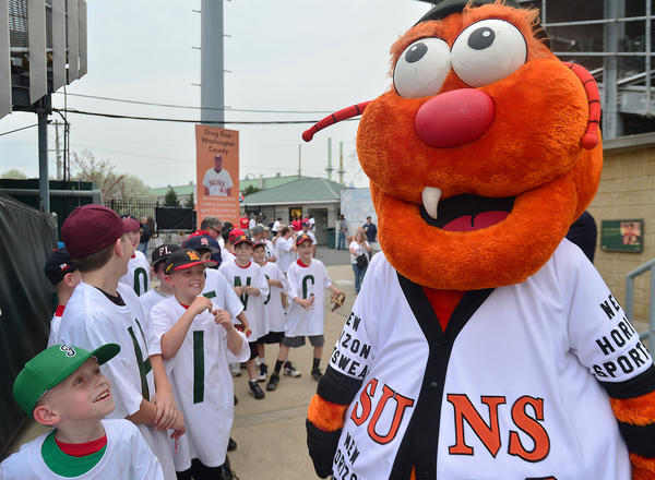 Hagerstown Suns mascot Woolie greets Federal Little League team members during the Hagerstown Suns home opener Thursday at Municipal Stadium in Hagerstown.