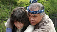 "In the biopic ""Leonie,"" the famous artists in a Japanese American family — the sculptor-architect Isamu Noguchi and his writer father — are supporting characters. The ""woman behind the men,"" Leonie Gilmour, steps out front and center. She's ferociously independent and unconventional, and played with a bright, chilly strength by Emily Mortimer. But one of the disappointments of the film is that she is, ultimately, defined by the success of her son."