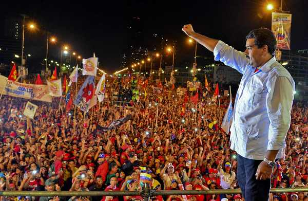 Venezuelan acting President and presidential candidate Nicolas Maduro gestures during his closing campaign rally in Caracas on April 11, 2013 ahead od Sunday's presidential election.