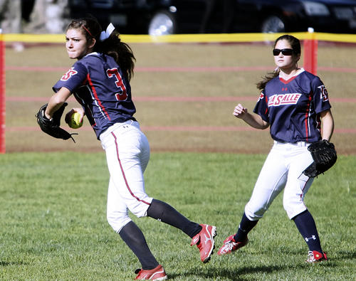 La Salle's #3 Beverlee Valerio looks to throw the ball back into the infield during home game vs. Maranatha at Latter Day Saints softball field in Pasadena on Thursday, April 11, 2013. Maranatha won the game.
