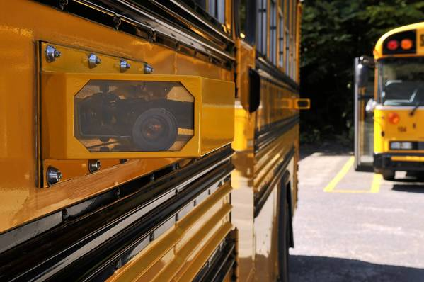 Amid scandal within its red-light camera program, Redflex is expanding into automated school bus cameras that record cars as they illegally pass.