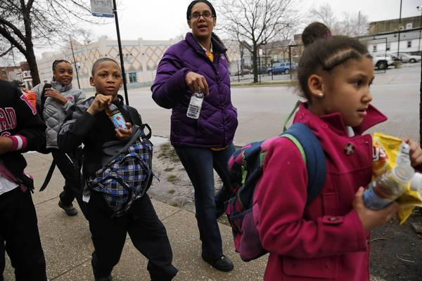 Marshetta Ross walks her children Markhail, 10, second from left, and Markhasia, 7, right, home from their after-school program across the street from Calhoun North. At left is Ross' niece Ashanti Toney, 10.