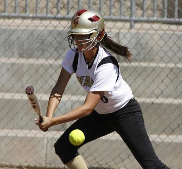 Glendale Community College's Claire Ortiz goes for a slap hit in a game with Bakersfield College.