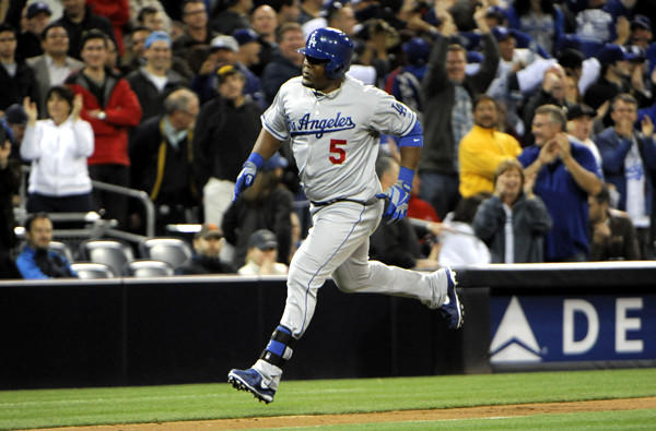 Dodgers pinch-hitter Juan Uribe rounds the bases after hitting a go-ahead solo home run against the Padres in the eighth inning Thursday night at Petco Park.