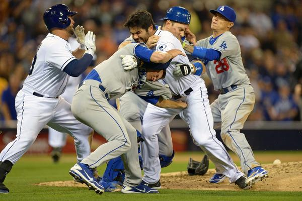San Diego Padres left fielder Carlos Quentin (middle right) and Los Angeles Dodgers starting pitcher Zack Greinke (middle left) tangle Thursday night.