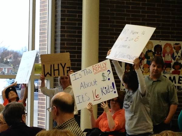 Parents from the Batavia Highlands neighborhood protest at a recent District 304 school board meeting a proposal to switch their neighborhood's elementary school to Western Avenue School.