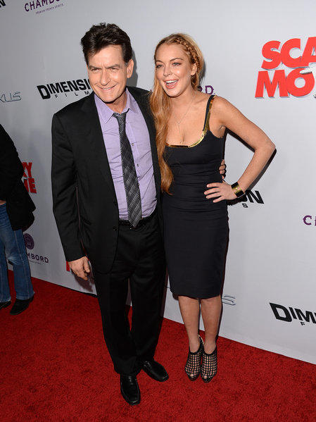 "Charlie Sheen and Lindsay Lohan share a smile at the ""Scary Movie 5"" premiere in Hollywood on Thursday."