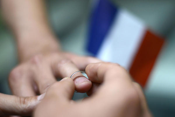 Men exchange rings in a symbolic ceremony in Paris in September 2012.