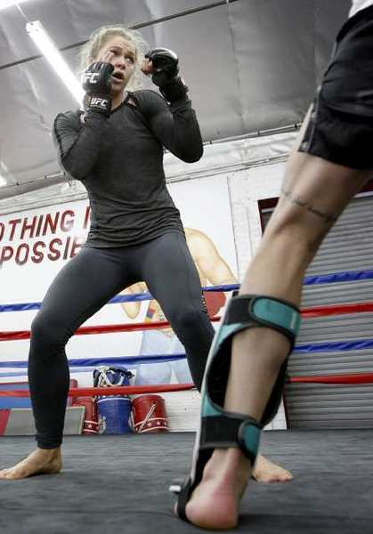 UFC Champion Ronda Rousey keeps her guard up during training session at the Glendale Fighting Club in Glendale.