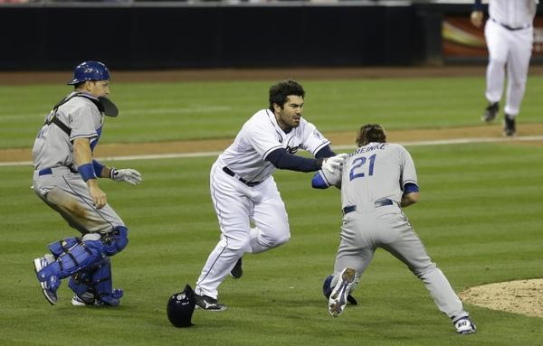 Carlos Quentin charges at Zack Greinke after being hit by a pitch.