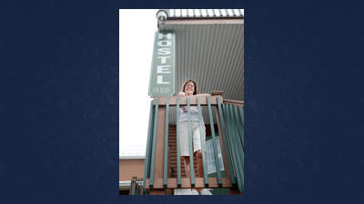 Judy Pletcher stands on the back porch of The Hostel on Main in Rockwood.