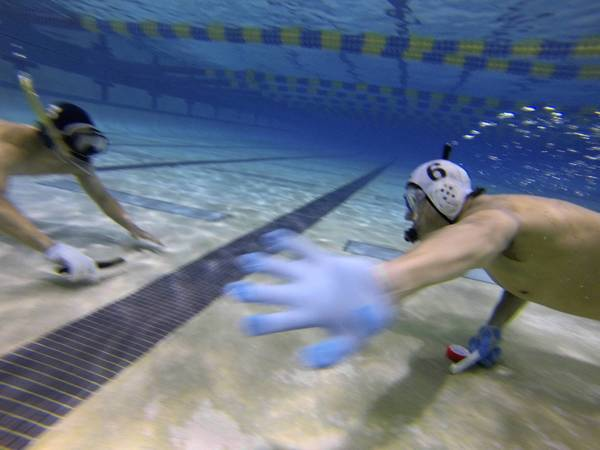 Players on the YCF Underwater Hockey club go head-to-head during a practice match at the YMCA Aquatic Center on International Drive.