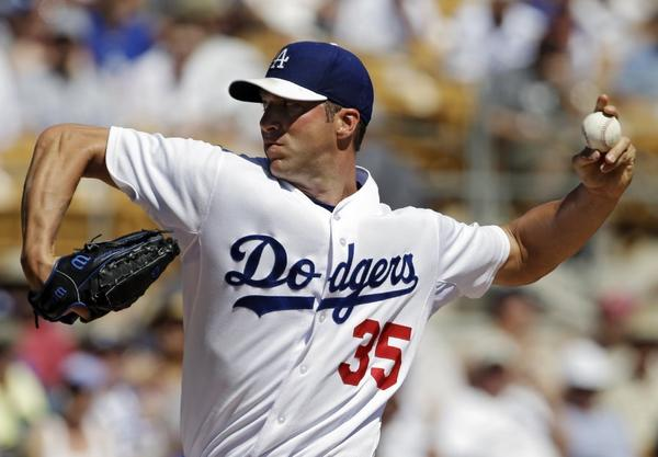 Will Chris Capuano, above, replace the injured Zack Greinke in the Dodgers' pitching rotation?