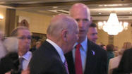 H. Wayne Huizenga getting a pat on the back from Gov. Rick Scott