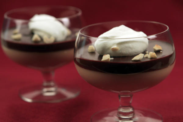 Caramel budino layered with chocolate ganache, served with whipped sour cream and toasted nuts.