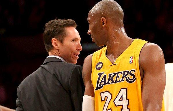 Steve Nash, chatting with teammate Kobe Bryant, will be in street clothes again Friday night when the Lakers host Golden State.