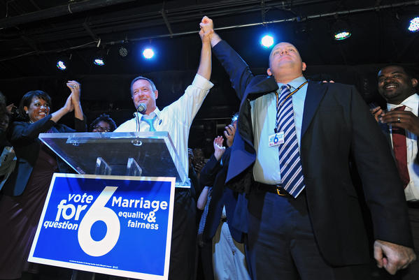 Maryland Gov. Martin O'Malley, center, celebrates with Josh Levin after the passage of Question 6 for same-sex marriage, at The Sound Stage on election night.