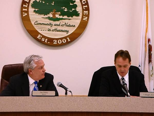 Homer Glen Mayor Jim Daley and Village Attorney Cary Horvath talk at the April 10 Village Board meeting where trustees voted to place a moratorium on the issuance of building permits for construction of any residence in three unfinished subdivisions.