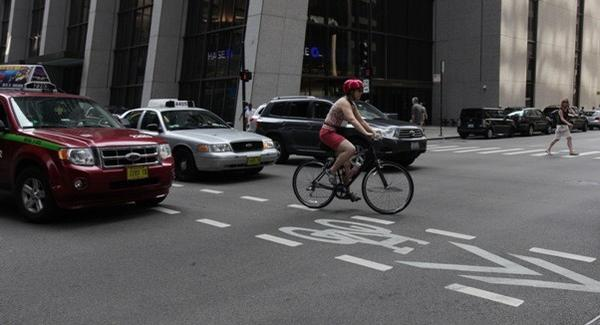 A bicyclist uses a bike lane on Madison Street in the Loop.