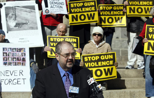Stephen Miller, owner of Miller Guitar Academy in Mishawaka, speaks at a news conference in South Bend April 3. He has experienced the devastation of gun violence in his family and is lobbying for gun law reform. (South Bend Tribune/GREG SWIERCZ)