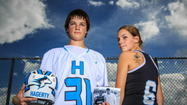 Hagerty lacrosse players Jake McCarthy and Katie Schwab played this season after the death of one of their parents. Jake's dad, John, died of leukemia, and Katie has a tattoo on the back of his left shoulder to honor her mom Linda, who died of a brain aneurysm. (Joshua C. Cruey, Orlando Sentinel)