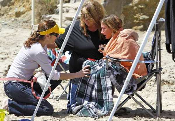A woman, right, is comforted at the scene where a 51-year-old diver from Orange County was reported missing and later found by rescue personal at Shaw's Cove. The diver was part of a group and after a head count it was determined he was missing. The man was rushed to Hoag Hospital on a lifeguard boat.