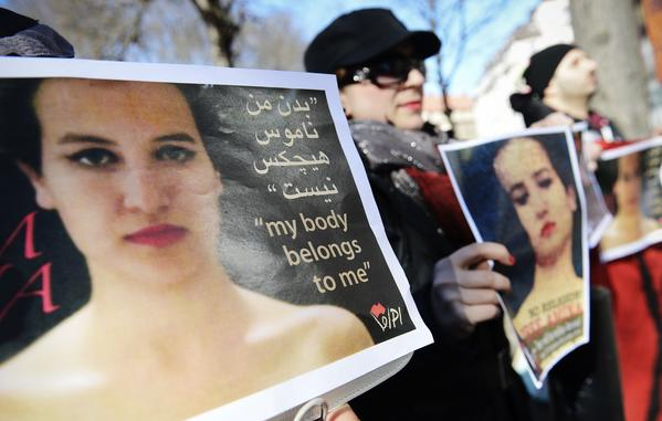 Activists hold images of Amina Tyler on April 4 as they take part in a protest outside the Tunisian Embassy in Stockholm.