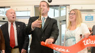 A grand opening was held Friday for a Walgreens store on Dual Highway, the second Walgreens pharmacy to open in the area within two weeks.