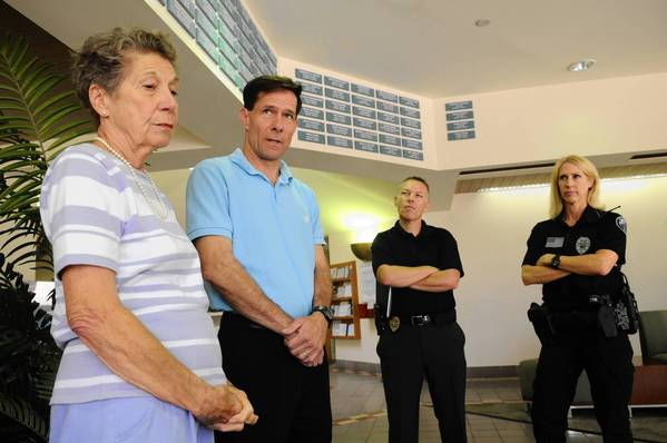 Nancy Crum, the mother of homicide victim Julie Wills, comes to Boca Raton 17 years after the murder to talk to investigators about the unsolved case. Her son, Art Crum III, stands with his mother in the lobby of the Boca Raton Police Dept. along with Detective Hanley and police as they talk to the media about the unsolved case.