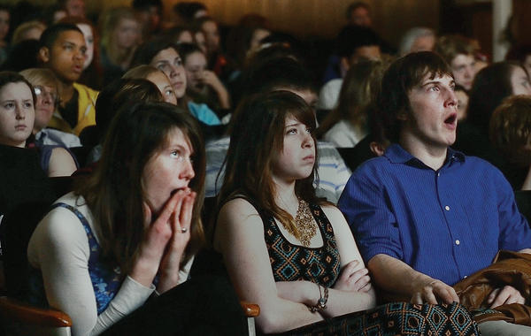 Mariah Chapelle, left, Hannah Smyle and Bradley Hull view several short films produced by professionals during the Maryland International Film Festival at Bridge of Life on Friday. The three are Boonsboro High School students .