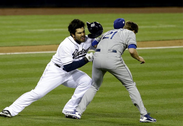 San Diego Padres outfielder Carlos Quentin charges into Dodgers pitcher Zack Greinke after being hit by a pitch.