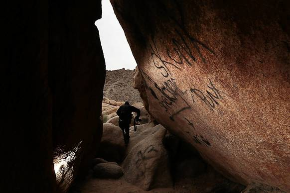 Graffiti mars rocks on a sacred Indian site inside Rattlesnake Canyon in Joshua Tree National Park.