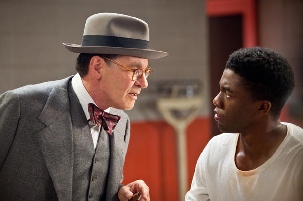 "Harrison Ford, left, as Branch Rickey and Chadwick Boseman (right) as Jackie Robinson in ""42."""