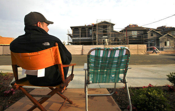 Chris Thibodeau, a biotech executive, waits in line to buy into a new Huntington Beach subdivision.