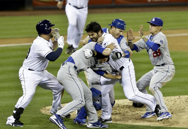 San Diego Padres and Dodgers players brawl after Padres outfielder Carlos Quentin charged the mound.