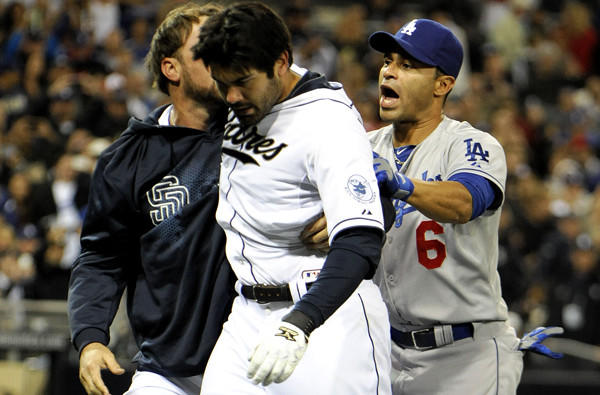 Padres reserve outfielder Mark Kotsay and Dodgers utility player Jerry Hairston Jr. escort San Diego's Carlos Quentin off the field after he charged the mound and tackled starting pitcher Zack Greinke, who hit him with a pitch in the sixth inning Thursday night.
