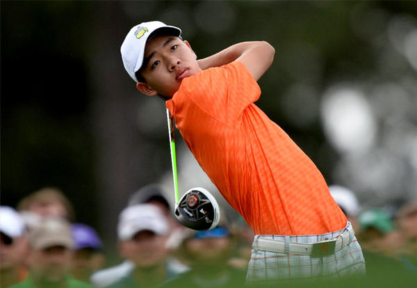 Tianlang Guan plays during the second round of the Masters golf tournament at Augusta National.