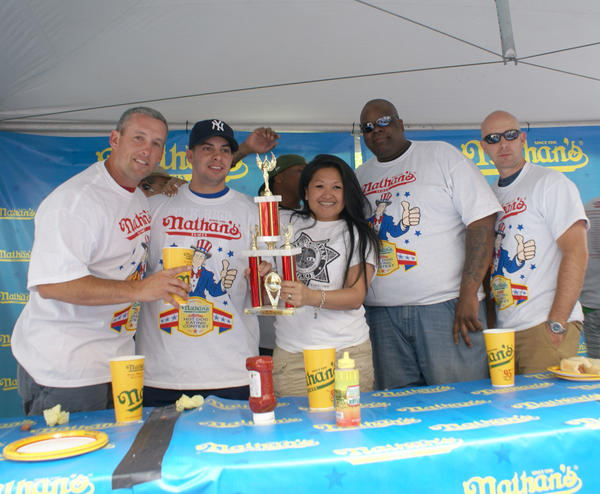 Officers from the Las Vegas Metropolitan Police Department downed a combined 26 hot dogs to win a competition among first responders and military personnel during the 2012 contest at New York-New York.