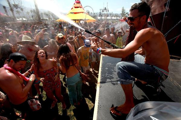 Festival-goers revel in cold water spray in the Do LaB during the first day of the Coachella Music & Arts Festival.