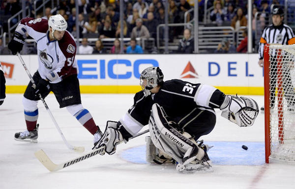 Kings goalie Jonathan Quick allows a goal to Colorado Avalanche left wing Patrick Bordeleau.