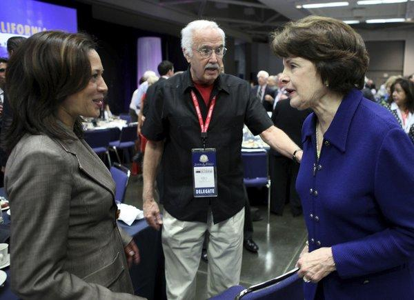 Democratic State Chairman John Burton chats with U.S. Sen. Dianne Feinstein, right, and California Atty. Gen. Kamala Harris, left, at the party's 2011 state convention in Sacramento.