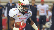 The quarterback of Maryland's past — and presumably its future — stood on the sideline with a ball cap and a headset, signaling in plays.