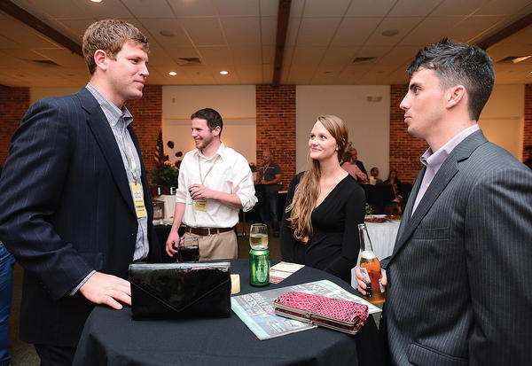 "Waynesboro residents and film makers,from left, William Derrick writer/producer of the movie ""LION,"" Lauren Henicle and ""LION"" producer/director Mitch Walck, relax Friday night during the Maryland International Film Festival reception at the Academy Theatre prior to view their film and two other films."