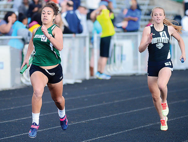 South Hagerstown's Hayley Freeman, left, running the anchor leg of the girls 4x200 relay, heads to the finish line for the victory on Friday.