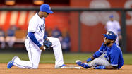 Toronto Blue Jays shortstop Jose Reyes was carted off the field Friday night after he appeared to hurt his left ankle while sliding into second base against the Royals in Kansas City, Mo.