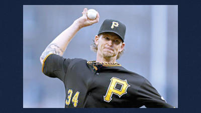 Pittsburgh Pirates starting pitcher A.J. Burnett (34) delivers during the first inning of a baseball game Friday against the Cincinnati Reds in Pittsburgh.